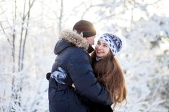 Young couple in the winter park Royalty Free Stock Photos