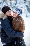 Young couple in the winter park Stock Photos