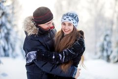 Young couple in the winter park Royalty Free Stock Photography