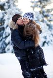 Young couple in the winter park Royalty Free Stock Image