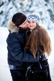Young couple in the winter park Royalty Free Stock Images