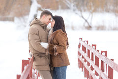 Young couple in winter park love and kiss Stock Image