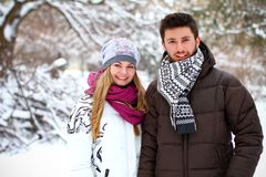 Young couple in winter park outdoors Royalty Free Stock Photography