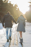 Young Couple in Winter Park walking. Family Outdoors. love Royalty Free Stock Photography