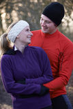 Young Couple On Winter Run Through Woodland royalty free stock images