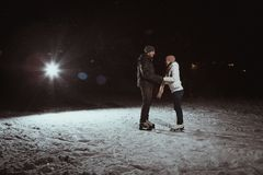 Young couple in  winter  skate rink Royalty Free Stock Photo