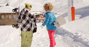 Young couple in a winter ski resort Royalty Free Stock Image