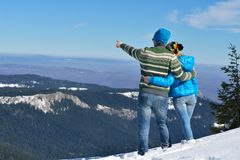 Young Couple In Winter  Snow Scene Royalty Free Stock Photography