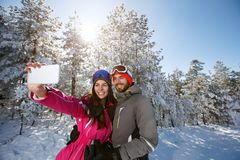 Couple on winter taking photo outdoor stock photography