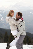 Young Couple On Winter Vacation Stock Photos