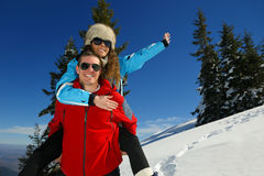 Young couple on winter vacation Royalty Free Stock Image