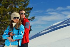 Young couple on winter vacation Stock Images