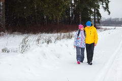 Young couple in the winter woods. Royalty Free Stock Photography
