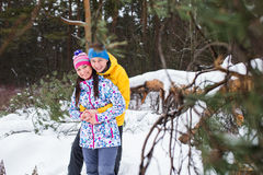 Young couple in the winter woods. Royalty Free Stock Images