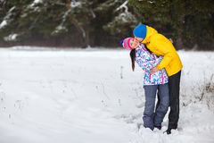Young couple in the winter woods. Royalty Free Stock Photos