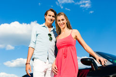 Free Young Couple With Cabriolet In Summer On Day Trip Stock Photos - 28876123