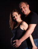 Young Couple With Pregnant Wife Royalty Free Stock Images