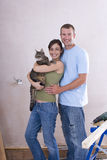 Young couple, woman with cat, smiling, portrait. Young couple, women with cat, smiling, portrait royalty free stock photography