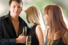 Young couple and woman holding glasses with champagne Royalty Free Stock Photography
