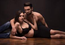 Young couple woman man lying laying, sexy bra shirtless Royalty Free Stock Photo