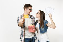 Young couple, woman and man in 3d glasses watching movie film on date holding bucket of popcorn, say cloud with royalty free stock photography