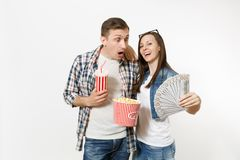 Young couple, woman and man watching movie film on date holding bucket of popcorn plastic cup of soda or cola and bundle. Young couple, women and men watching royalty free stock photos