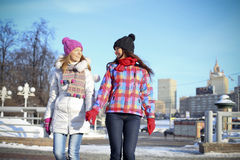 Young couple women in winter street Stock Images