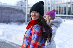Young couple women in winter street Royalty Free Stock Photos