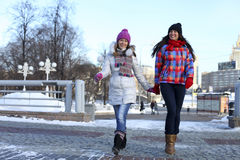 Young couple women in winter street Royalty Free Stock Photo