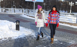 Young couple women in winter street Royalty Free Stock Images