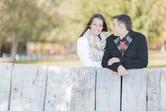 Young couple by the wooden fence Royalty Free Stock Photo
