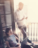 Young couple work together. Photo woman and bearded man working with new startup project in modern loft. Using Royalty Free Stock Photo