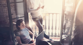 Young couple work together. Photo woman and man working with new startup project in modern loft. Using contemporary Stock Photos