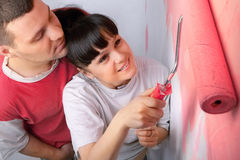Young couple of workers painting Stock Image