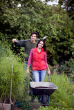 A young couple working on an allotment Stock Photography