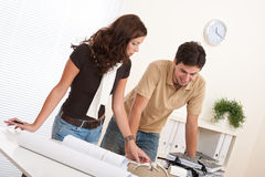 Young couple working at architect office Royalty Free Stock Images