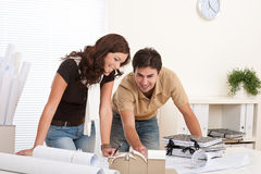 Young couple working at architect office Stock Photo