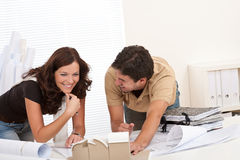 Young couple working at architect office Stock Image