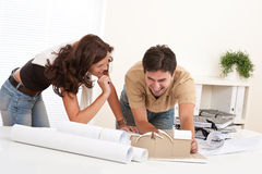 Young couple working at architect office Royalty Free Stock Image