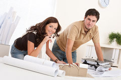 Young couple working at architect office Stock Photography