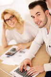 Young couple working on documents at home Stock Photo