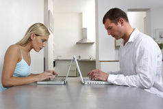 Young couple working from home Stock Photography
