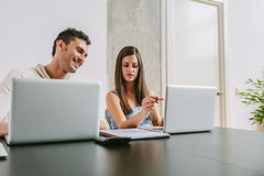 Young Couple Working at Home Stock Photos