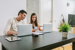 Young Couple Working at Home Royalty Free Stock Images