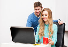 Young couple working with laptop Royalty Free Stock Photography