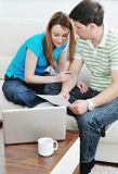 Young couple working on laptop at home Royalty Free Stock Image