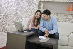 Young couple working on laptop at home Royalty Free Stock Photo