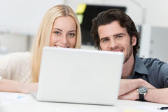 Young couple working on a laptop at home Royalty Free Stock Image