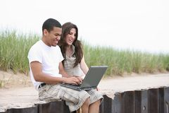 Young Couple Working on Laptop Outdoor Stock Image