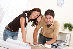 Young couple working at office Stock Images